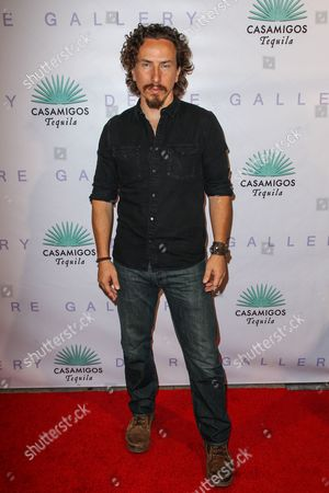 """Michael Traynor attends the Brian Bowen Smith's """"Metallic Life"""" Exhibition Debut at the De Re Gallery on in Los Angeles"""