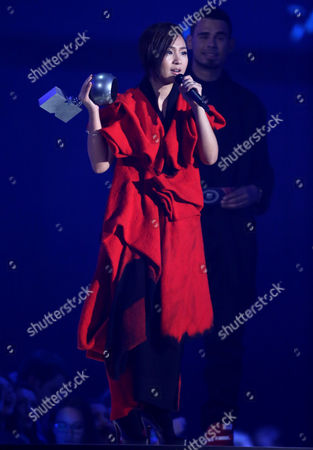 Bibi Zhou on stage during the 2014 MTV European Music Awards in Glasgow