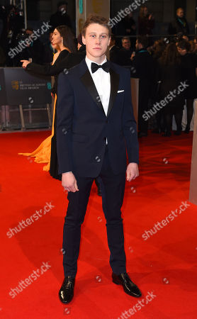 George McKay arrives for the British Academy Film and Television Awards 2015, The BAFTAs, at the Royal Opera House, in London