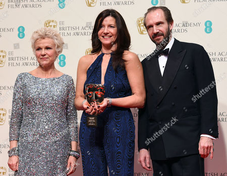 Julie Walters, left and Ralph Fiennes, right, pose with Christine Langan, winner of Outstanding Contribution to British Film for The BBC, in the winners room, during the British Academy Film and Television Awards 2015, at the Royal Opera House, in London