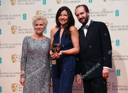 Julie Walters and Ralph Fiennes with Christine Langan, winner of Outstanding Contribution to British Film for The BBC, pose for photographers in the winners room, at the British Academy Film and Television Awards 2015, The BAFTAs, at the Royal Opera House, in London