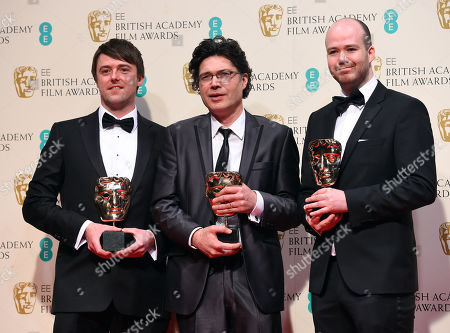 From left, Brian J. Falconer, Ronan Blaney and Michael Lennox, winners of the Best Short film, Boogaloo and Graham, pose for photographers in the winners room, during the British Academy Film and Television Awards 2015, at the Royal Opera House, in London