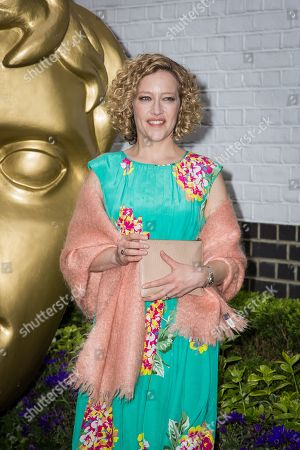 Cathy Newman poses for photographers upon arrival at the British Academy Television Craft Awards in London