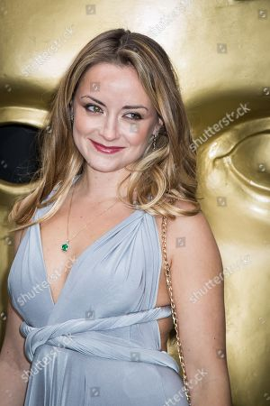 Faye Thomas poses for photographers upon arrival at the British Academy Television Craft Awards in London
