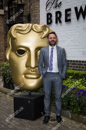 Shaun Keaveny poses for photographers upon arrival at the British Academy Television Craft Awards in London