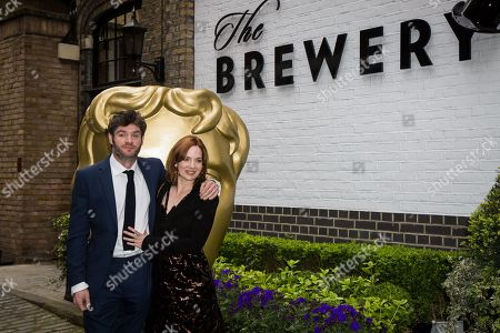 Stock Image of Harry Peacock and Katherine Parkinson pose for photographers upon arrival at the British Academy Television Craft Awards in London