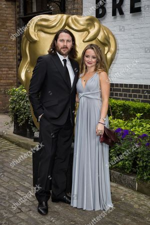 Kieran Bew and Faye Thomas pose for photographers upon arrival at the British Academy Television Craft Awards in London