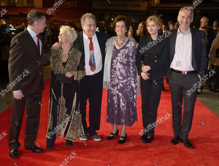 """From left to right, English actor Steve Coogan, English actress Dame Judi Dench, British director Stephen Frears, Philomena Lee, Scottish actress Sophie Kennedy Clark and British author Martin Sixsmith arrive at the American Express Gala Screening of """"Philomena"""" at the Odeon West End during the 57th BFI London Film Festival in partnership with American Express®, in London"""