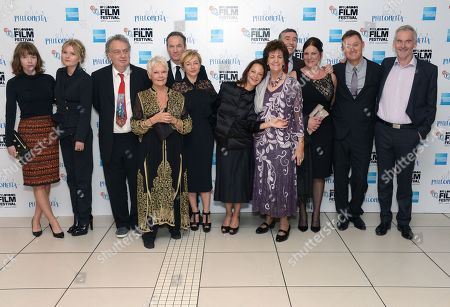 """From left, actresses Anna Maxwell Martin and Sophie Kennedy Clark, director Stephen Frears, actress Dame Judi Dench, actor Sean Mahon, producers Tracey Seaward and Gabrielle Tana, Philomena Lee, actor Steve Coogan, Jane Libberton, screenwriter Jeff Pope and author Martin Sixsmith pose together at the American Express Gala Screening of """"Philomena"""" at the Odeon West End during the 57th BFI London Film Festival in partnership with American Express®, in London"""