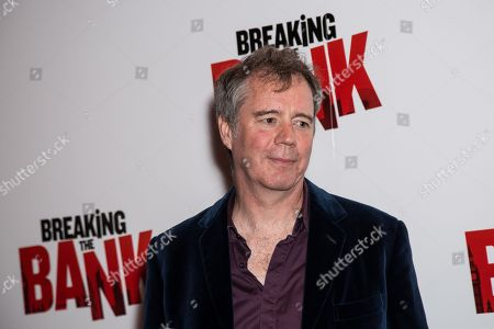 Director Vadim Jean poses for photographers upon arrival at the premiere of the film 'Breaking the Bank' in London