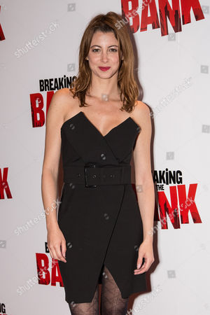 Actress Julie Dray poses for photographers upon arrival at the premiere of the film 'Breaking the Bank' in London