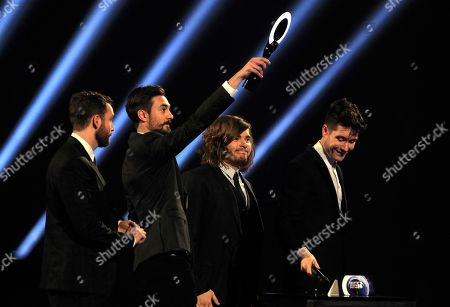 From left, Dan Smith, Kyle J Simmons, Chris 'Woody' Wood, and William Farquarson of British band Bastille are seen on stage after winning the British Breakthrough Act award at the BRIT Awards 2014 at the O2 Arena in London on