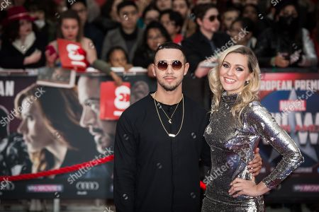 Mason Noise and Larissa Eddie pose for photographers upon arrival at the premiere of the film 'Captain America Civil War' in London