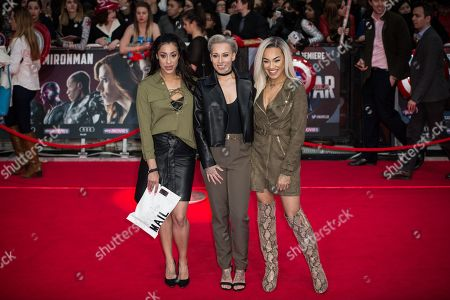 Alexandra Buggs, Courtney Rumbold and Karis Anderson of Stooshe pose for photographers upon arrival at the premiere of the film 'Captain America Civil War' in London
