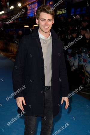 Stock Photo of Thomas Law poses for photographers upon arrival at the premiere of the film 'Eddie The Eagle' in London