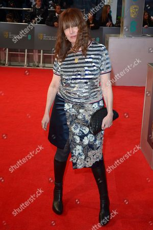 Production designer Judy Becker poses for photographers on the red carpet at the EE British Academy Film Awards held at the Royal Opera House, in London