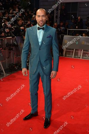John Carew poses for photographers on the red carpet at the EE British Academy Film Awards held at the Royal Opera House, in London