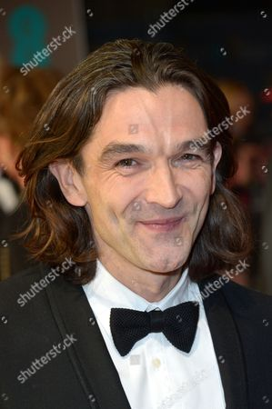 Justin Chadwick poses for photographers on the red carpet at the EE British Academy Film Awards held at the Royal Opera House, in London