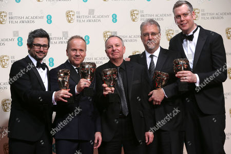 From left, Christopher Benstead, Skip Lievsay, Chris Munro, Glenn Freemantle and Niv Adiri, winners of best sound pose for photographers in the winners room at the EE British Academy Film Awards held at the Royal Opera House, in London