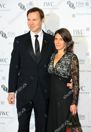 David Morrissey and Esther Freud pose on the red carpet for the media on arrival for the British Film Institute London Film Festival Gala Dinner in central London, on