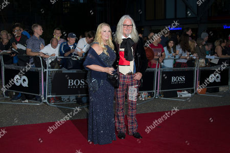 Billy Connolly and wife Pamela Stephenson pose for photographers upon arrival at the GQ magazine Awards at the Tate Modern in London