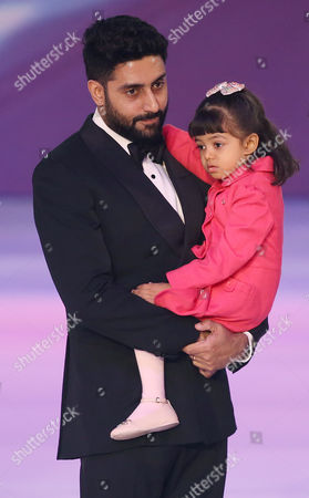 Abhishek Bachchan and daughter Aaradhya Bachchan, during the Miss World 2014 final, on stage at the Excel centre in east London