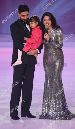 Former Miss World Aishwarya Rai, right speaks on stage with husband Abhishek Bachchan and daughter Aaradhya Bachchan, during the Miss World 2014 final, on stage at the Excel centre in east London
