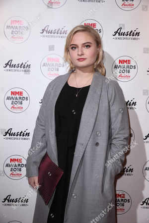 Lapsley poses for photographers upon arrival at the NME 2016 music awards in London