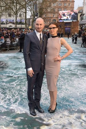 Director Darren Aronofsky and girlfriend Canadian producer Brandi-Ann Milbradt arrive at the UK premiere of Noah in Leicester Square, London