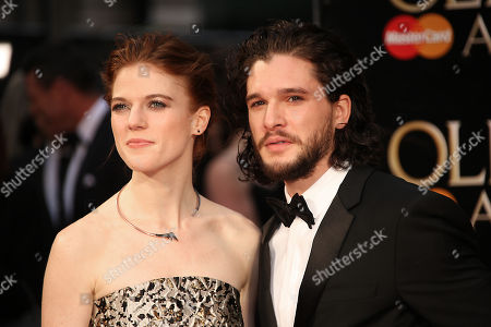 Actors Rose Leslie, left, and Kit Harrington pose for photographers upon arrival at the Olivier Awards in London