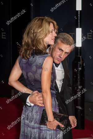 Judith Holste and Christoph Waltz pose for photographers upon arrival at the world premiere of the latest James Bond film, 'Spectre' in London
