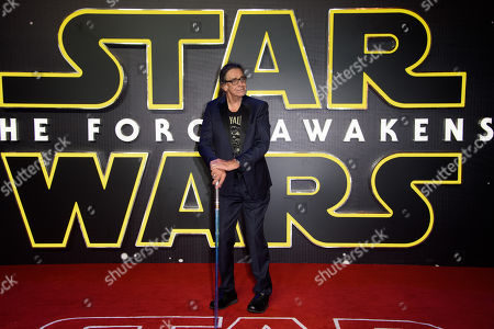 Peter Mayhew poses for photographers upon arrival at the European premiere of the film 'Star Wars: The Force Awakens ' in London