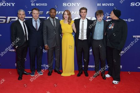 From left, producer Matthew Tolmach, director Marc Webb, actors Jamie Foxx, Emma Stone, Andrew Garfield, Dane DeHaan and producer Avi Arad pose for photographers at the world premiere of The Amazing Spider-Man 2 in Leicester Square, London