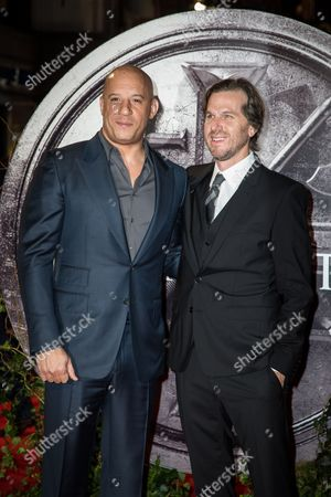 Vin Diesel and director Breck Eisner pose for photographers upon arrival at the premiere of the film 'The Last Witch Hunter' in London