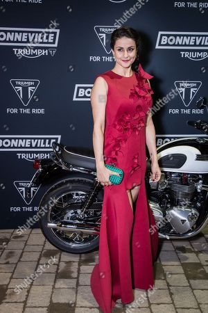 Gul Panag poses for photographers upon arrival at the Triumph Motorcycle Launch Party in London