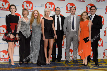 The cast of Call the Midwife, Charlotte Ritchie, Jenny Agutter, Victoria Yeates, Helen George, Ben Caplan, Jack Ashton, Laura Main and Stephen McGann poses for photographers at the TV Choice Awards 2015 at a central London venue, London