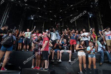 Fans are onstage as Jay Electronica performs at Made In America Festival, in Philadelphia. Police in Philadelphia say they've had to clear an outdoor concert stage after more than 1,000 people rushed it during a Labor Day weekend show