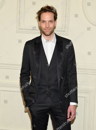 Andy Gillet arrives at the CHANEL Paris-Salzburg 2014/15 Metiers d'Art Collection fashion show at the Park Avenue Armory, in New York