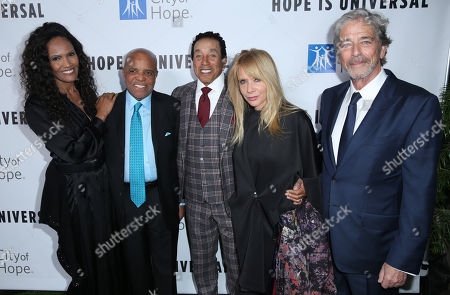 Eskedar Gobeze, from left, Berry Gordy, Smokey Robinson, Rosanna Arquette, and Todd Morgan arrive at the City of Hope's Spirit of Life Gala, honoring UMG's Chairman and CEO Lucian Grainge at the Santa Monica Civic on