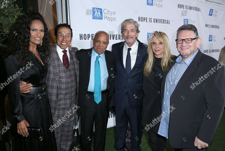 Eskedar Gobeze, from left, Smokey Robinson, Berry Gordy, Todd Morgan, Rosanna Arquette, and Lucian Grainge, Spirit of Life honoree, arrive at the City of Hopeâ?™s Spirit of Life Gala, honoring UMG's Chairman and CEO Lucian Grainge at the Santa Monica Civic on