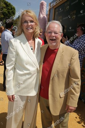 """Stock Image of Producer Bonne Radford and Author Roger S. Baum seen at Clarius Entertainment Los Angeles Premiere of """"Legends of Oz: Dorothy's Return"""" at Regency Village Theater, in Los Angeles, CA"""