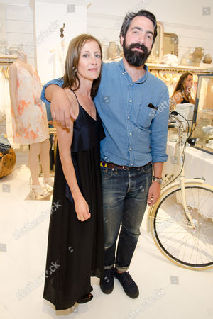 Stock Picture of Caroline Belhumeur and Aaron Levine attend a Club Monaco store opening event in Southampton on in New York