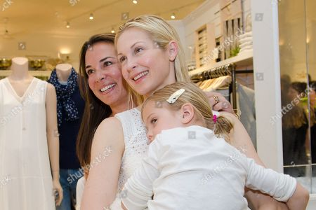 Samantha Yanks, Kelly Rutherford, and Kelly's daughter Helena, attend a Club Monaco store opening event in Southampton on in New York