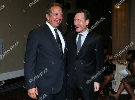Jeremy Zimmer, left, and Bryan Cranston attend the CoachArt Gala of Champions in Beverly Hills, Calif. on