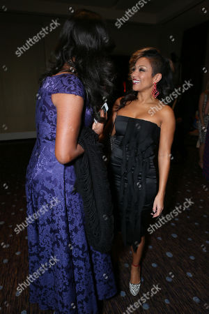 Shondrella Avery, left, and Chante Moore attend the CoachArt Gala of Champions in Beverly Hills, Calif. on