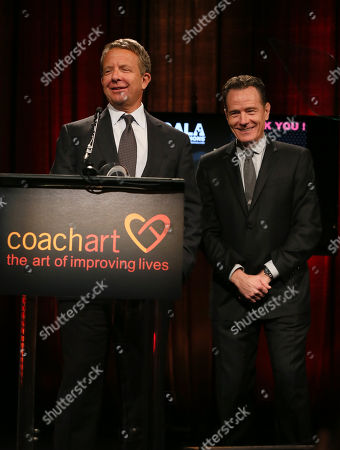 Jeremy Zimmer, CEO and co-founder of UTA, left, and presenter Bryan Cranston speak on stage at the CoachArt Gala of Champions in Beverly Hills, Calif. on
