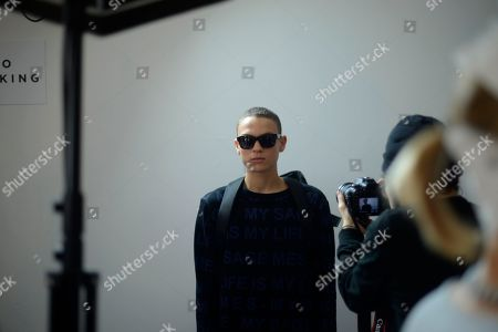 Stock Picture of A model, Joel Mignott, wears a design from the Matthew Miller collection backstage during London Collections: Men AW14, in London