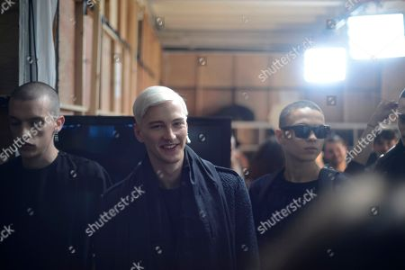 Stock Photo of Models, Daytona, Marjin and Joel Mignott wear designs from the Matthew Miller collection backstage during London Collections: Men AW14, in London