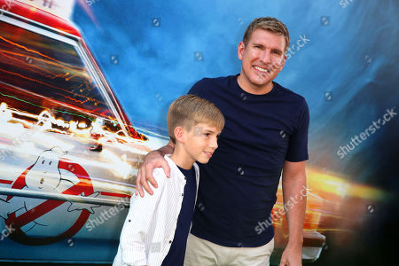 Grayson Chrisley and Todd Chrisley are seen at the Los Angeles Premiere of Columbia Pictures' Ghostbusters at TCL Chinese Theatre, in Los Angeles