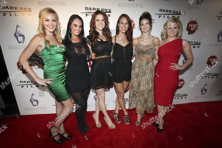 Stock Picture of From left, Femme Fatales television show actresses Madison Dylan, Kristen Deluca, Catherine Annett, Stacy Stas, Tiffany Brouwer and Nikki Griffin arrive to the Fear Net and Resident Evil Party at Voyeur Nightclub for Comic-Con weekend, in San Diego